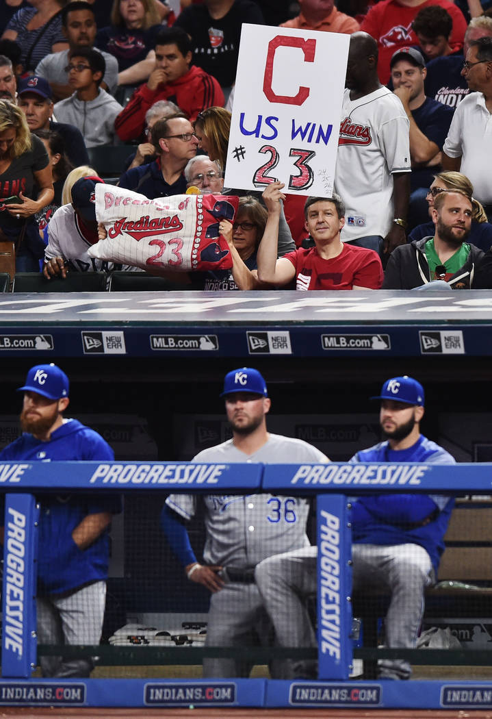 Sep 15, 2017; Cleveland, OH, USA; Cleveland Indians fans hold signs in support of the Indians 22 game winning streak during the game against the Kansas City Royals at Progressive Field. (Ken Blaze ...