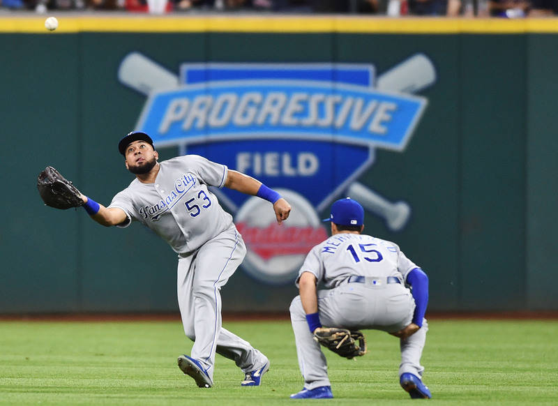 Sep 15, 2017; Cleveland, OH, USA; Kansas City Royals right fielder Melky Cabrera (53) makes the catch as second baseman Whit Merrifield (15) ducks out of the way on a hit by Cleveland Indians firs ...