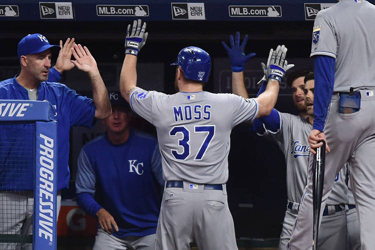 Sep 15, 2017; Cleveland, OH, USA; Kansas City Royals designated hitter Brandon Moss (37) celebrates in the dugout after hitting a home run during the fourth inning against the Cleveland Indians at ...