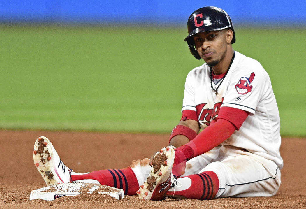 Cleveland Indians' Francisco Lindor sits near second base after being forced out in a double play in the seventh inning of a baseball game against the Kansas City Royals, Friday, Sept. 15, 2017, i ...