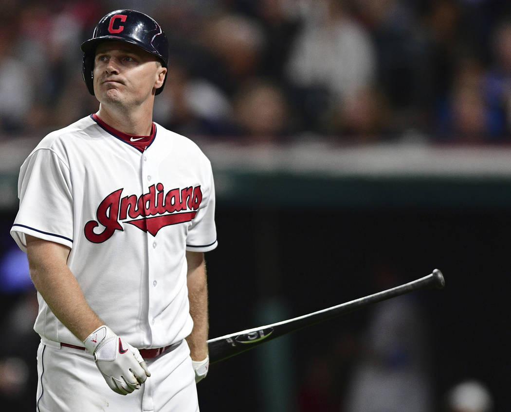 Cleveland Indians' Jay Bruce walks to the dugout after striking out in the sixth inning of a baseball game against the Kansas City Royals, Friday, Sept. 15, 2017, in Cleveland. (AP Photo/David Dermer)