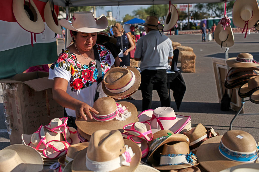 Elizabeth Santamaria Bahena organizes her display during a Mexican Independence Day celebration in North Las Vegas, Saturday, Sept. 16, 2017. Joel Angel Juarez Las Vegas Review-Journal @jajuarezphoto