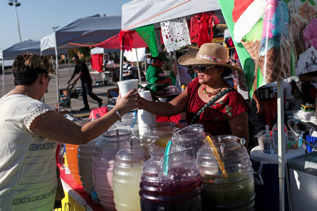 Raquel Rendon, left, buys juice from Paulina Lozano, right, during a Mexican Independence Day celebration in North Las Vegas, Saturday, Sept. 16, 2017. Joel Angel Juarez Las Vegas Review-Journal @ ...