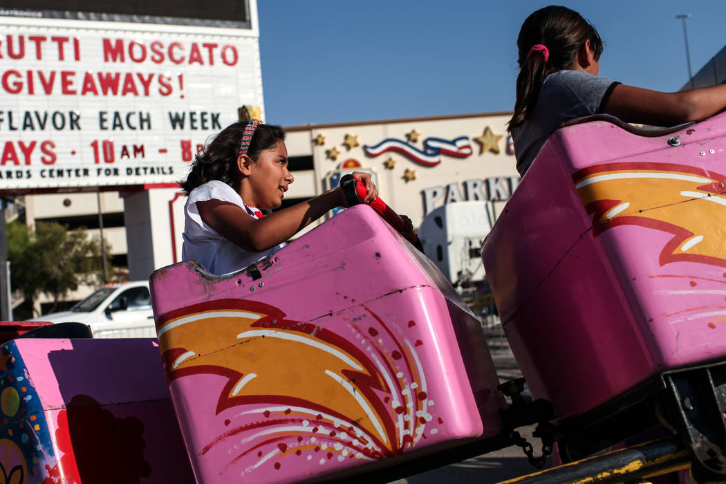 Valentina Escamilla, 9, rides a rollercoaster during a Mexican Independence Day celebration in North Las Vegas, Saturday, Sept. 16, 2017. Joel Angel Juarez Las Vegas Review-Journal @jajuarezphoto
