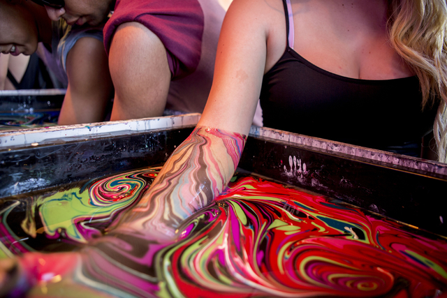 Life is Beautiful attendees get their arms coated in marble style paint at the music and arts festival Saturday afternoon, Sept. 24, 2016, in downtown Las Vegas. Elizabeth Page Brumley/Las Vegas R ...
