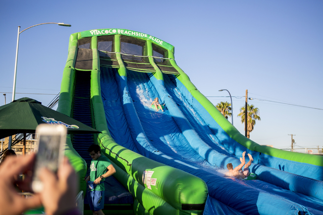 Life is Beautiful attendees go down the Vita Coco Beach Slide at the music and arts festival Saturday afternoon, Sept. 24, 2016, in downtown Las Vegas. Elizabeth Page Brumley/Las Vegas Review-Jour ...
