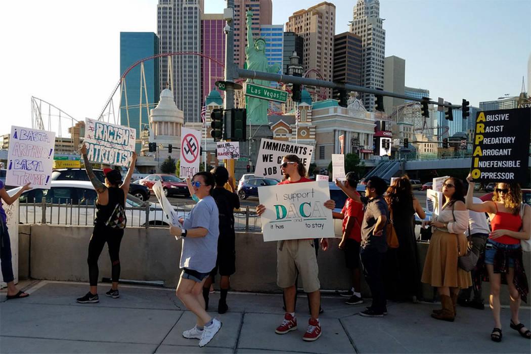 Demonstrators, protesting the visit of former Arizona sheriff Joe Arpaio, walk the Strip on Saturday. (Mike Shoro/Las Vegas Review-Journal)