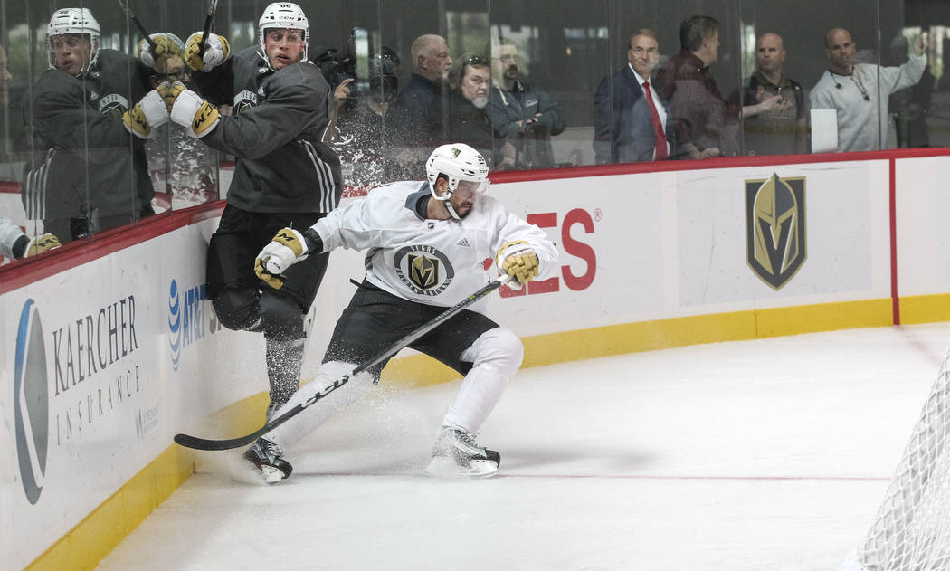 Vegas Golden Knights' Nate Schmidt, left, avoids being checked by Tomas Hyka in a scrimmage game during team practice at the City National Arena on Friday, Sept. 15, 2017, in Las Vegas. Richard Br ...