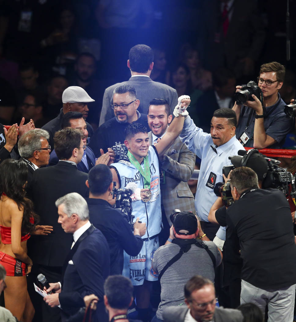 Joseph Diaz Jr. celebrates his unanimous win over Rafael Rivera, not pictured, during their WBC featherweight title eliminator boxing match at T-Mobile Arena in Las Vegas on Saturday, Sept. 16, 20 ...