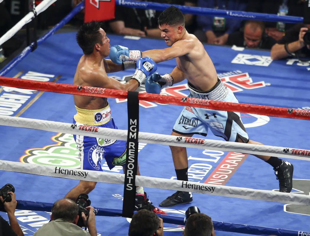 Joseph Diaz Jr., right, hits Rafael Rivera during their WBC featherweight title eliminator boxing match at T-Mobile Arena in Las Vegas on Saturday, Sept. 16, 2017. Chase Stevens Las Vegas Review-J ...