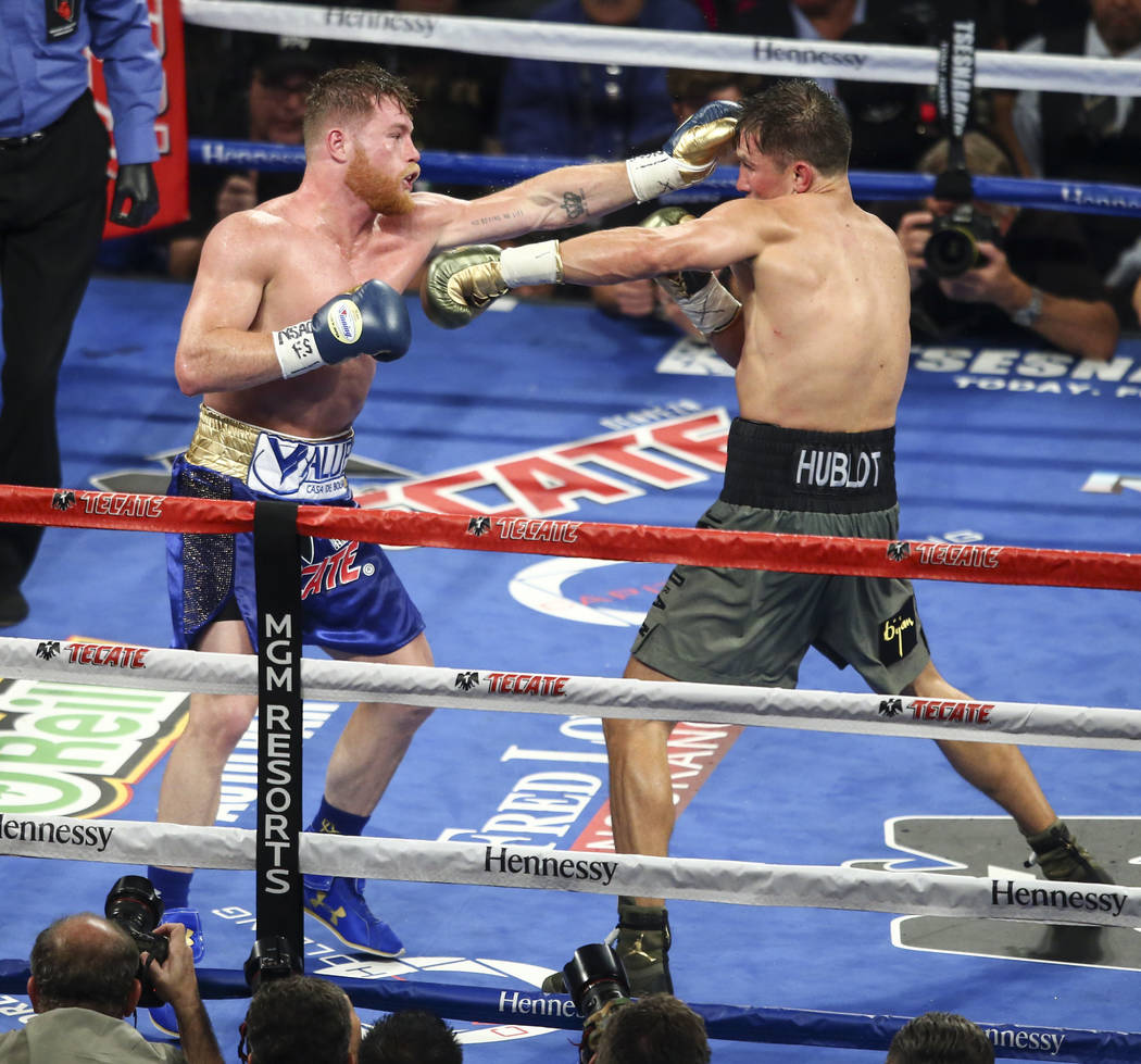 "Saul ""Canelo"" Alvarez, left, hits Gennady ҇GGӠGolovkin during their middleweight championship boxing match at T-Mobile Arena in Las Vegas on Saturday, Sept. 16, 2017. ..."