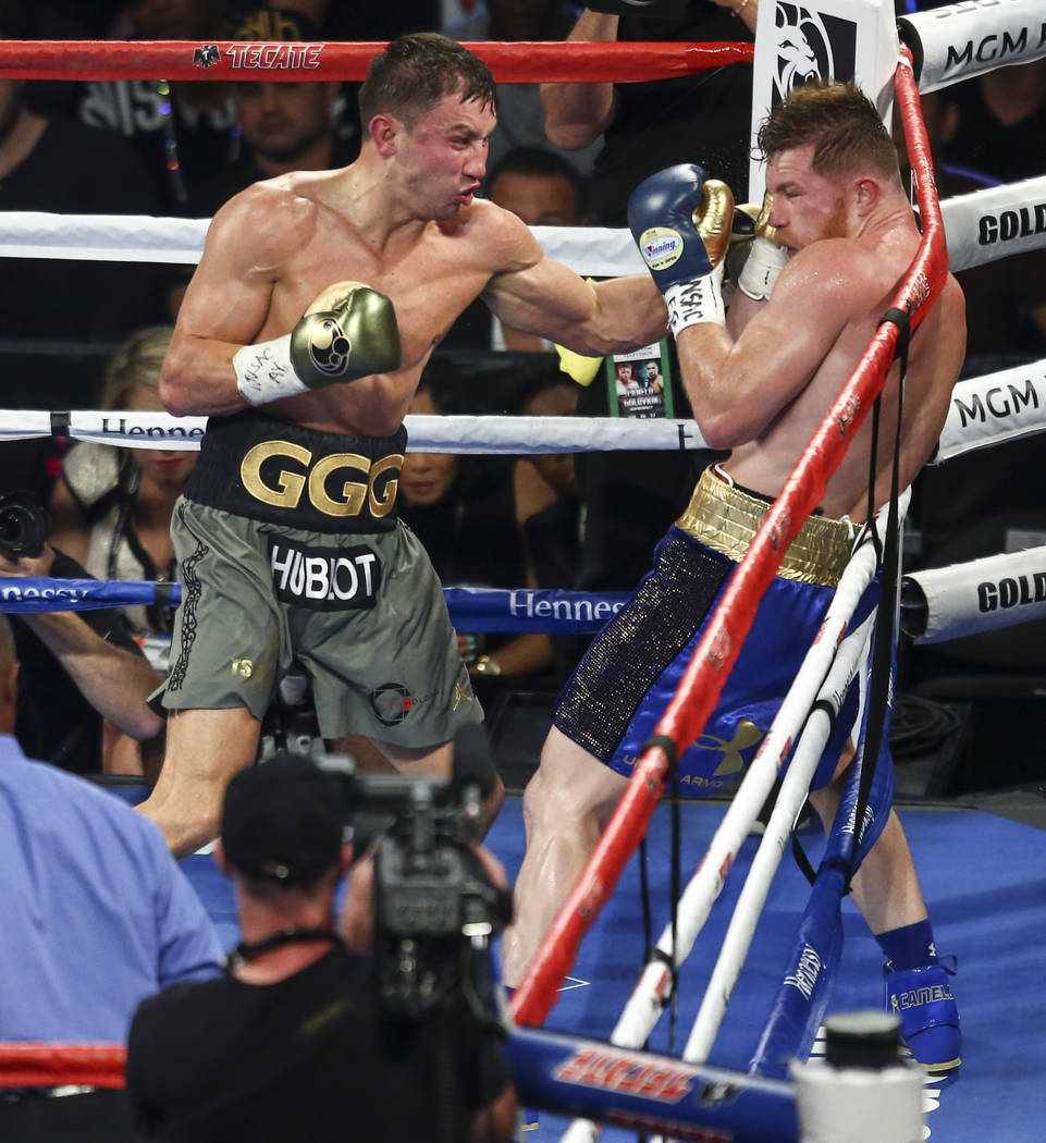 "Gennady ҇GGӠGolovkin, left, hits Saul ""Canelo"" Alvarez during their middleweight championship boxing match at T-Mobile Arena in Las Vegas on Saturday, Sept. 16, 2017. ..."