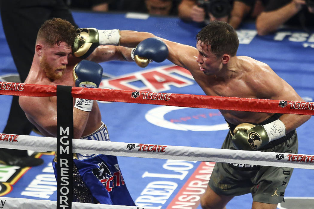 "Saul ""Canelo"" Alvarez, left, takes a hit from Gennady ""GGG"" Golovkin during their middleweight championship boxing match at T-Mobile Arena in Las Vegas on Saturday, ..."