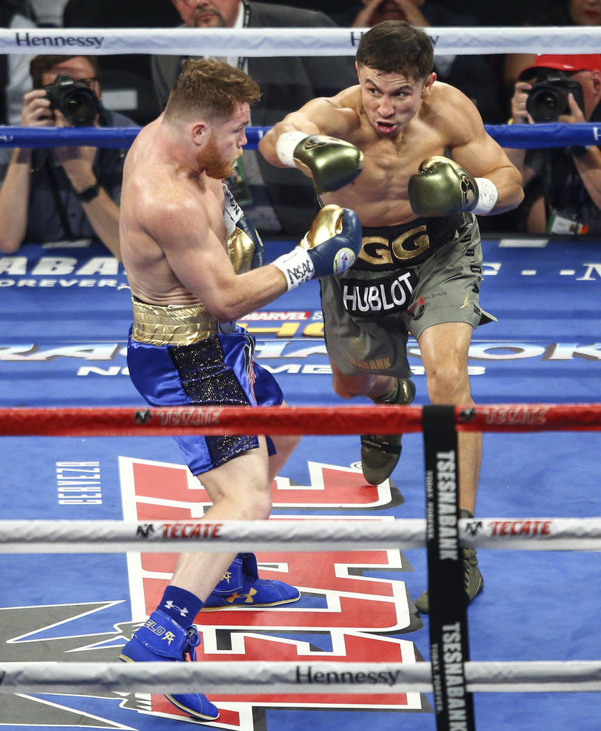 "Saul ""Canelo"" Alvarez, left, takes a hit from Gennady ҇GGӠGolovkin during their middleweight championship boxing match at T-Mobile Arena in Las Vegas on Saturday, Sep ..."