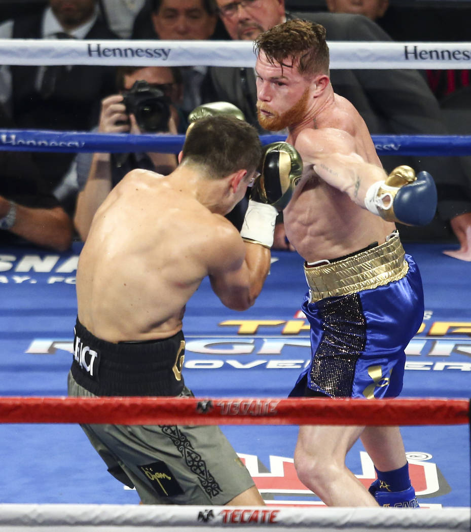 "Saul ""Canelo"" Alvarez, right, Gennady ҇GGӠGolovkin during their middleweight championship boxing match at T-Mobile Arena in Las Vegas on Saturday, Sept. 16, 2017. The ..."
