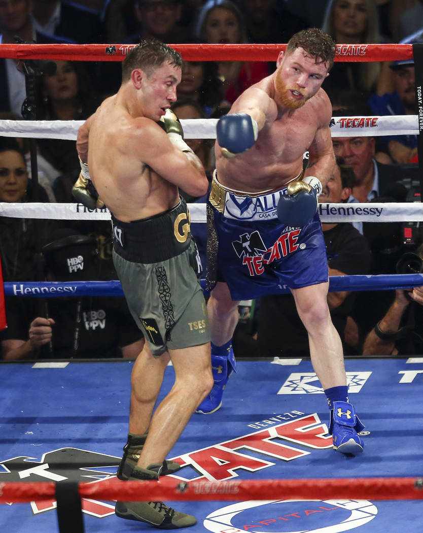"Saul ""Canelo"" Alvarez, right, hits Gennady ҇GGӠGolovkin during their middleweight championship boxing match at T-Mobile Arena in Las Vegas on Saturday, Sept. 16, 2017 ..."