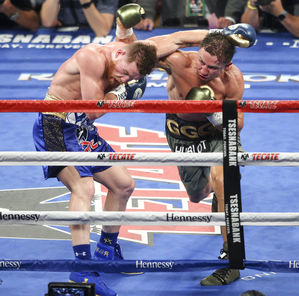 "Saul ""Canelo"" Alvarez, left, trades blows with Gennady ҇GGӠGolovkin during their middleweight championship boxing match at T-Mobile Arena in Las Vegas on Saturday, Se ..."