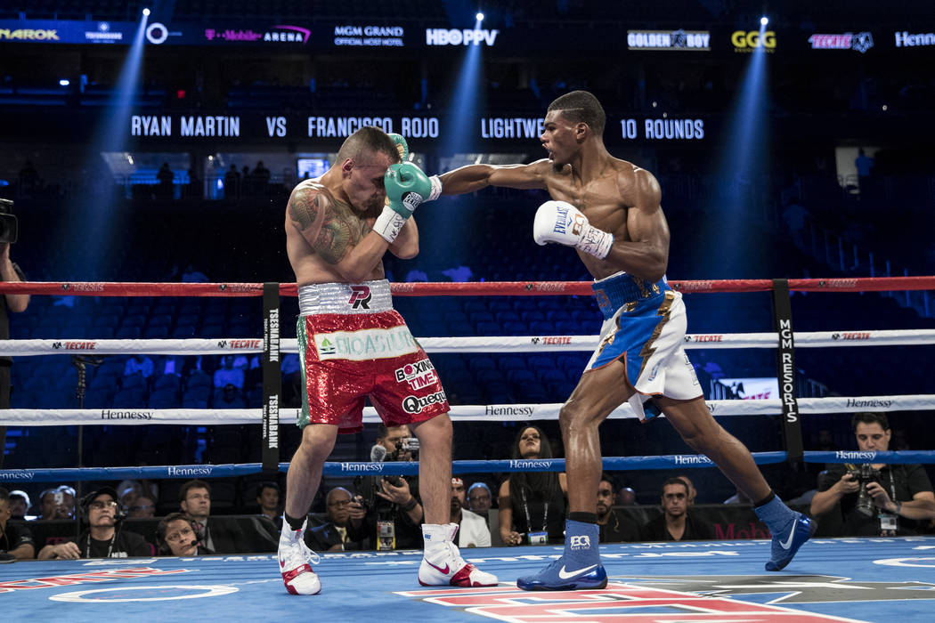 Ryan Martin, right, throws a punch against Francisco Rojo in the lightweight bout at T-Mobile Arena in Las Vegas, Saturday, Sept. 16, 2017. Martin won by split decision. Erik Verduzco Las Vegas Re ...