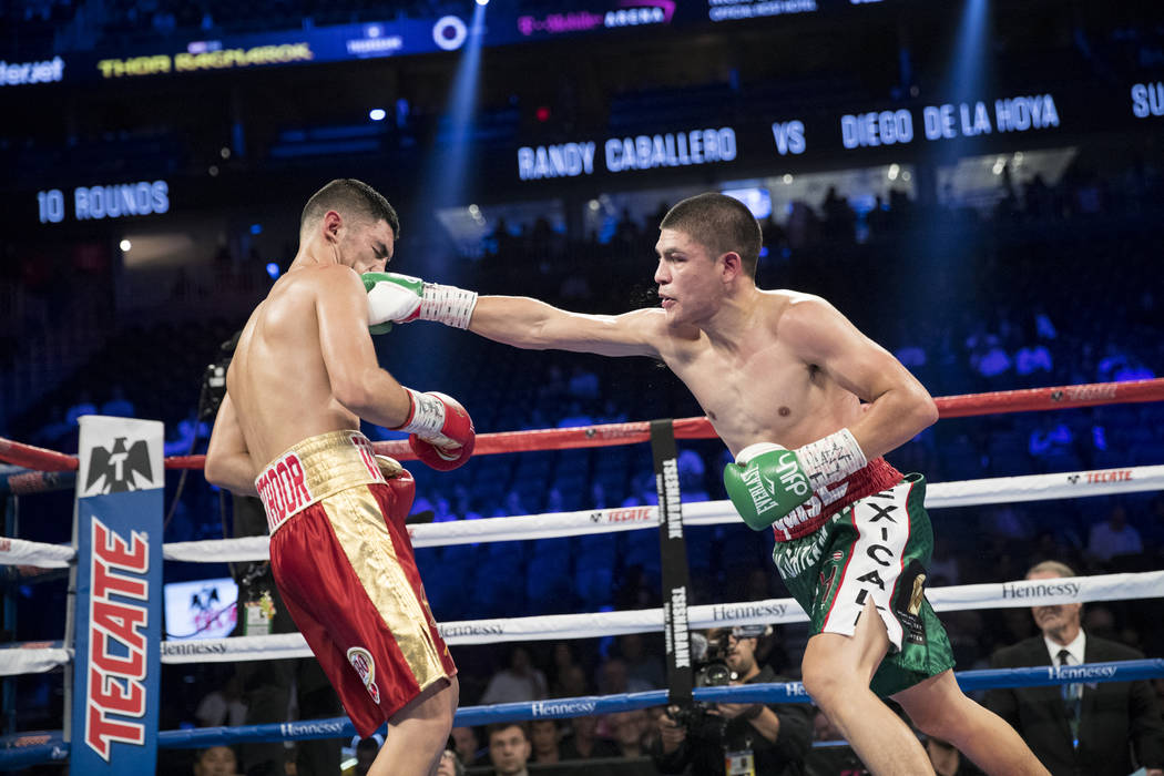Randy Caballero, left, takes a punch from Diego De La Hoya in the super bantamweight bout at T-Mobile Arena in Las Vegas, Saturday, Sept. 16, 2017. De La Hoya won by unanimous decision. Erik Verdu ...