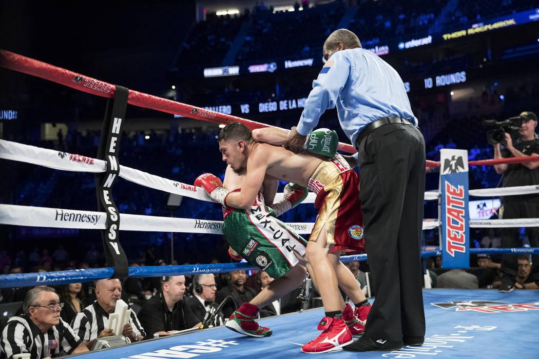 Diego De La Hoya, left, battles Randy Caballero in the super bantamweight bout at T-Mobile Arena in Las Vegas, Saturday, Sept. 16, 2017. De La Hoya won by unanimous decision. Erik Verduzco Las Veg ...