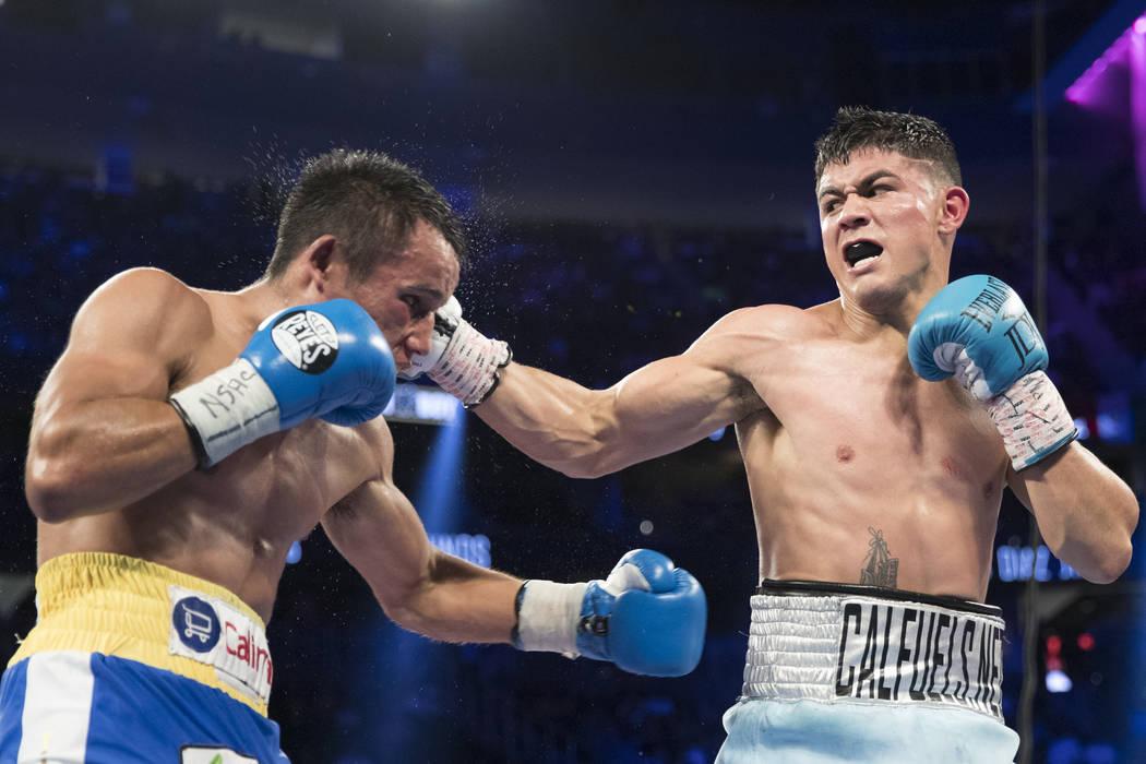 Rafael Rivera, left, battles Joseph Diaz Jr. in the featherweight bout at T-Mobile Arena in Las Vegas, Saturday, Sept. 16, 2017. Diaz won by unanimous decision. Erik Verduzco Las Vegas Review-Jour ...