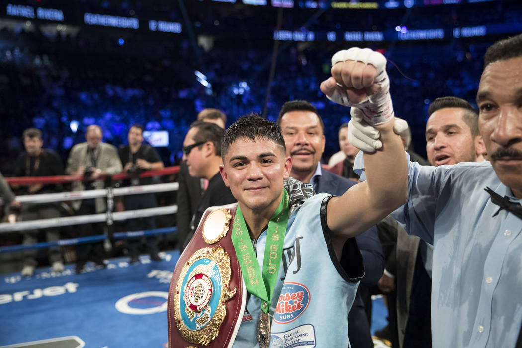 Joseph Diaz Jr. celebrates his unanimous victory against Rafael Rivera in the featherweight bout at T-Mobile Arena in Las Vegas, Saturday, Sept. 16, 2017. Diaz won by unanimous decision. Erik Verd ...
