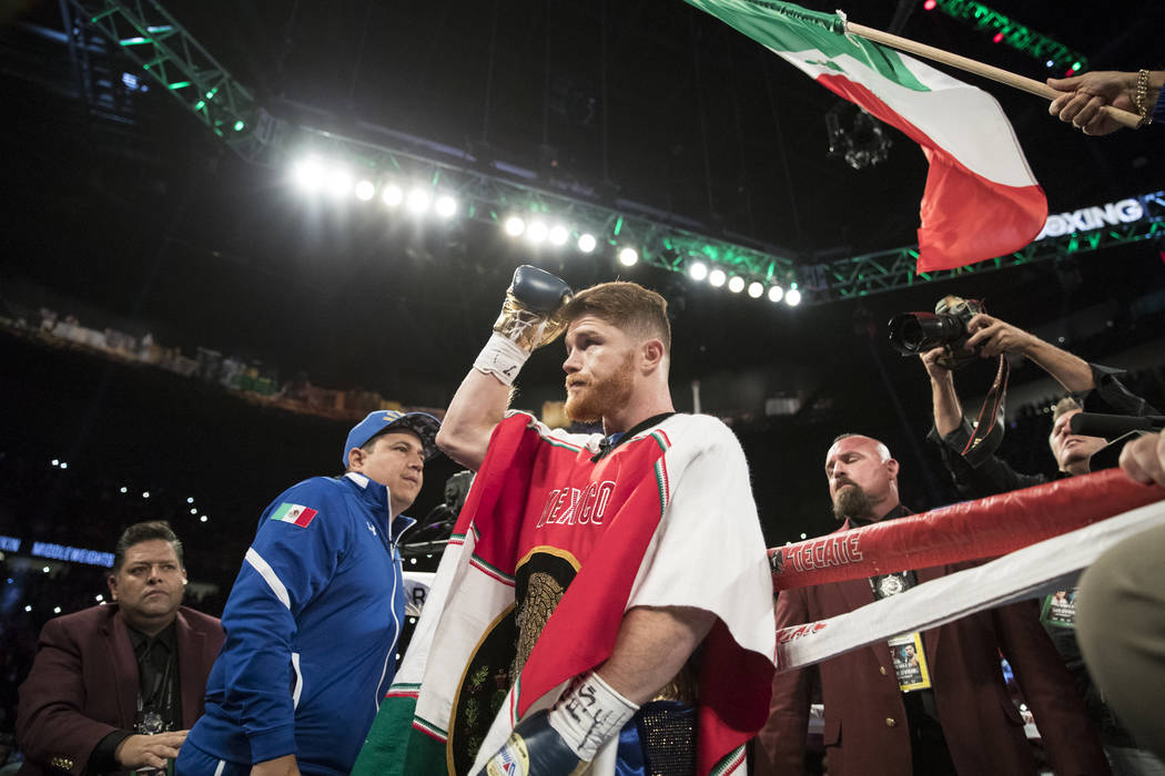 Saul Canelo Alvarez takes the ring for his fight against Gennady GGG Golovkin in the WBC, WBA, IBF, RING middleweight title bout at T-Mobile Arena in Las Vegas, Saturday, Sept. 16, 2017. The fight ...