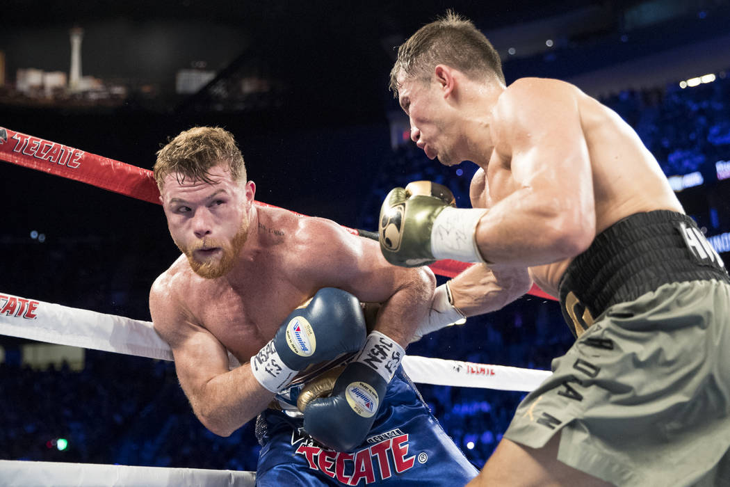 Saul Canelo Alvarez, left, battles Gennady GGG Golovkin in the WBC, WBA, IBF, RING middleweight title bout at T-Mobile Arena in Las Vegas, Saturday, Sept. 16, 2017. The fight ended in a split draw ...