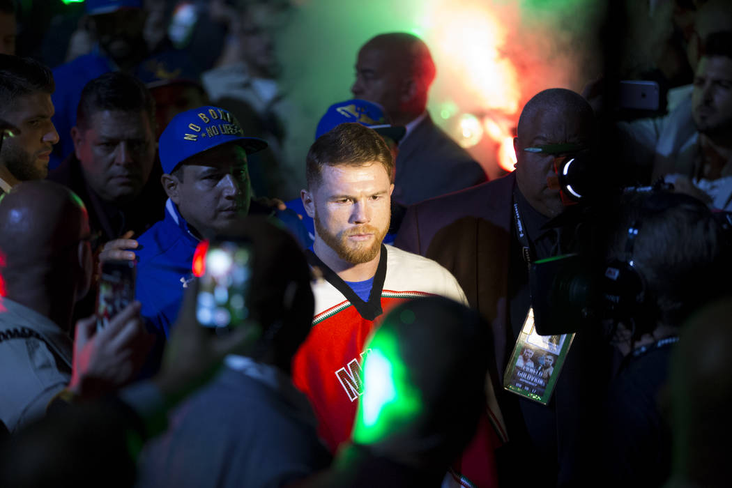 Saul Canelo Alvarez makes his way to the ring for his fight against Gennady GGG Golovkin in the WBC, WBA, IBF, RING middleweight title bout at T-Mobile Arena in Las Vegas, Saturday, Sept. 16, 2017 ...