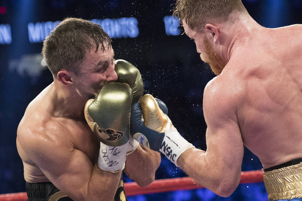 Gennady GGG Golovkin, left, defends a punch from Saul Canelo Alvarez in the WBC, WBA, IBF, RING middleweight title bout at T-Mobile Arena in Las Vegas, Saturday, Sept. 16, 2017. The fight ended in ...