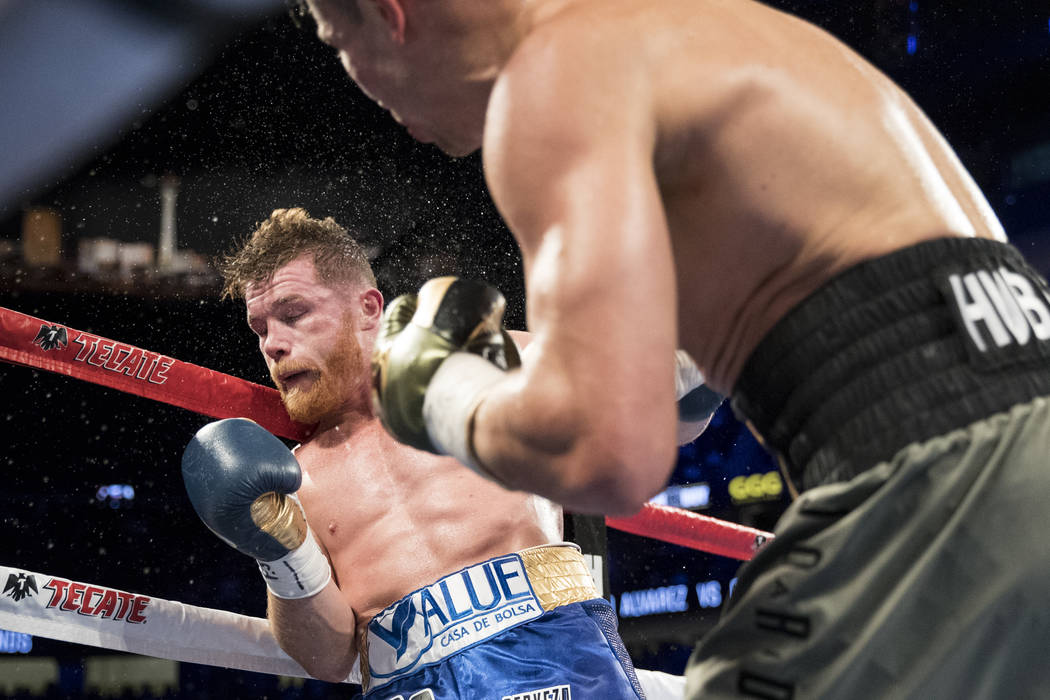 Gennady GGG Golovkin, right, after connecting a punch against Saul Canelo Alvarez in the WBC, WBA, IBF, RING middleweight title bout at T-Mobile Arena in Las Vegas, Saturday, Sept. 16, 2017. The f ...