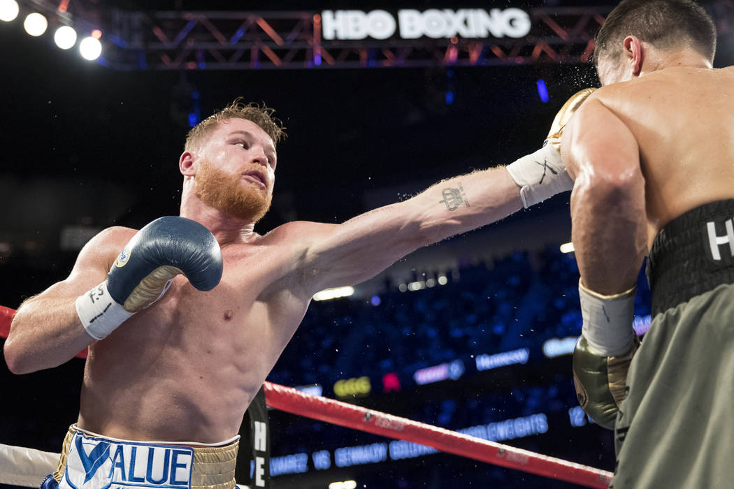 Saul Canelo Alvarez, left, battles Gennady GGG Golovkin in the WBC, WBA, IBF, RING middleweight title bout at T-Mobile Arena in Las Vegas, Saturday, Sept. 16, 2017. The fight ended in a draw. Erik ...