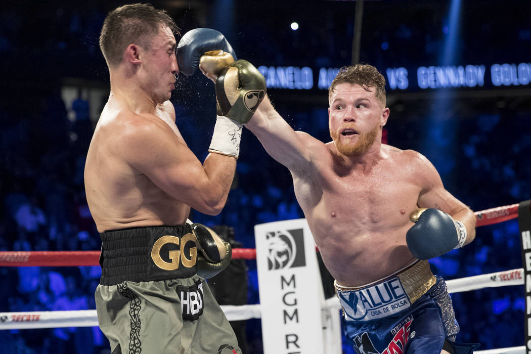 Saul Canelo Alvarez, right, connects a punch against  Gennady GGG Golovkin in the WBC, WBA, IBF, RING middleweight title bout at T-Mobile Arena in Las Vegas, Saturday, Sept. 16, 2017. The fight en ...