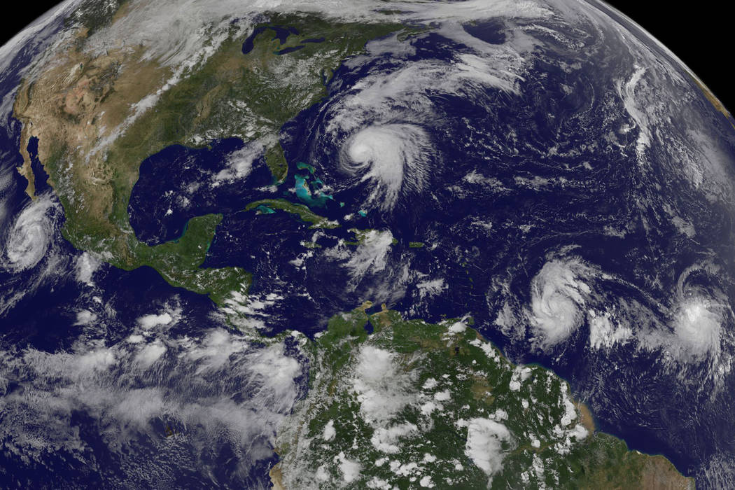Tropical weather systems Hurricane Norma, left, on the Pacific Ocean side of Mexico; Jose, center, east of Florida; Tropical Depression 15, second from right, north of South America, and Tropical  ...