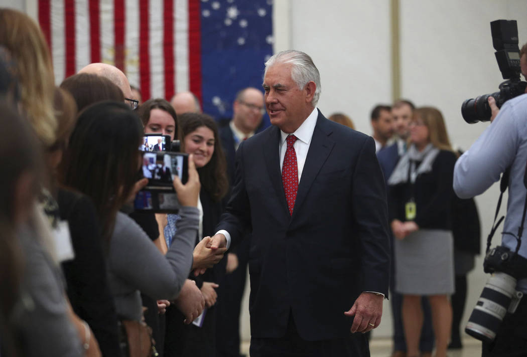 U.S. Secretary of State Rex Tillerson shakes hands with staff at the U.S. Embassy in London, Thursday, Sept. 14, 2017, during his second visit to Britain since taking office in February. (Hannah M ...