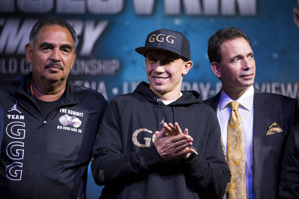 Gennady Golovkin, center, with his trainer Abel Sanchez, left, and his promoter Tom Loeffler, during a press conference at MGM Grand hotel-casino in Las Vegas, Wednesday, Sept. 13, 2017. Golovkin  ...