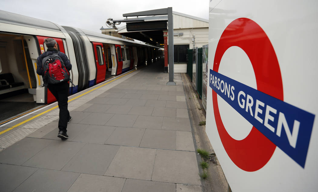 Travelers walk on the platform at Parsons Green tube station following Friday's incident on a tube at Parsons Green Station in London, Sunday, Sept. 17, 2017. A manhunt is under way after an impro ...