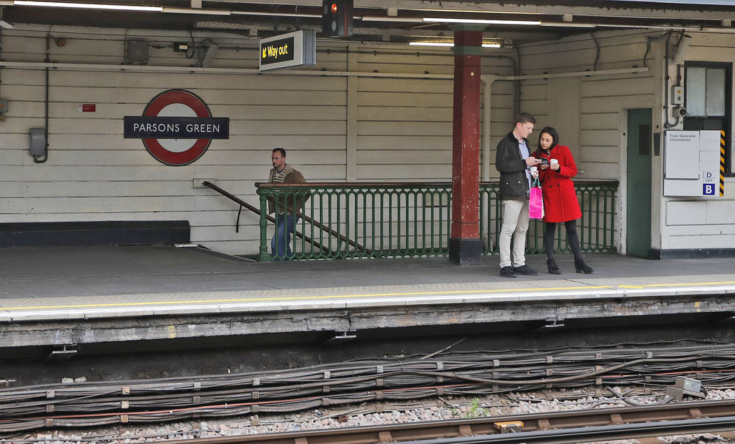 Travelers stand on the platform at Parsons Green tube station following Friday's incident on a tube at Parsons Green Station in London, Sunday, Sept. 17, 2017. A manhunt is under way after an impr ...