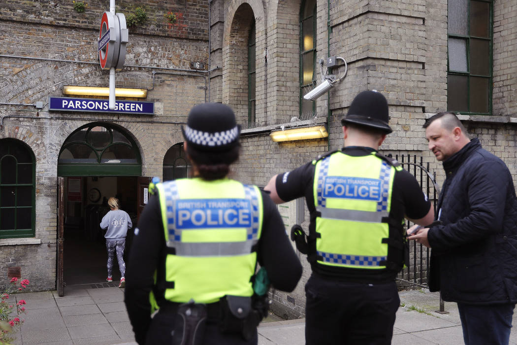 Police forces guard the entrance following Friday's incident on a tube at Parsons Green Station in London, Sunday, Sept. 17, 2017. (Frank Augstein/AP)