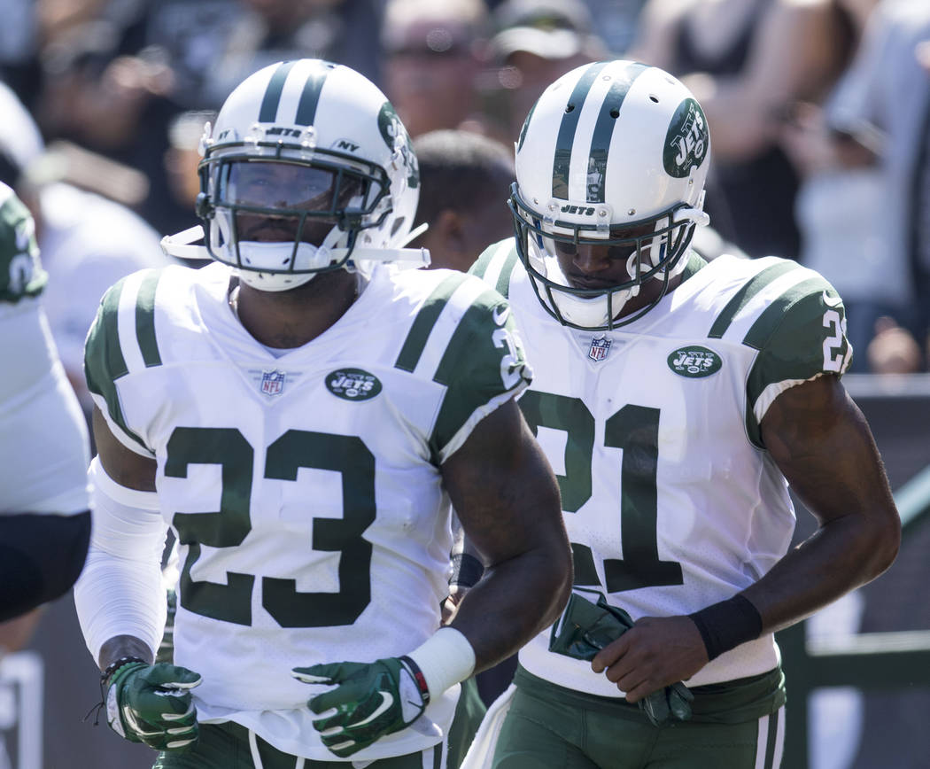 New York Jets defensive back Terrence Brooks (23) and cornerback Morris Claiborne (21) make their way onto the field in the first half of their game in Oakland, Calif., Sunday, Sept. 17, 2017. Hei ...