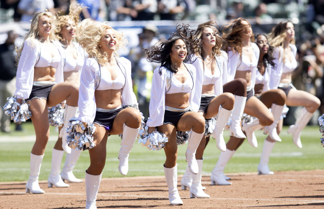 The Raiderettes perform prior to the Oakland Raiders game against the New York Jets in Oakland, Calif., Sunday, Sept. 17, 2017. Heidi Fang Las Vegas Review-Journal @HeidiFang
