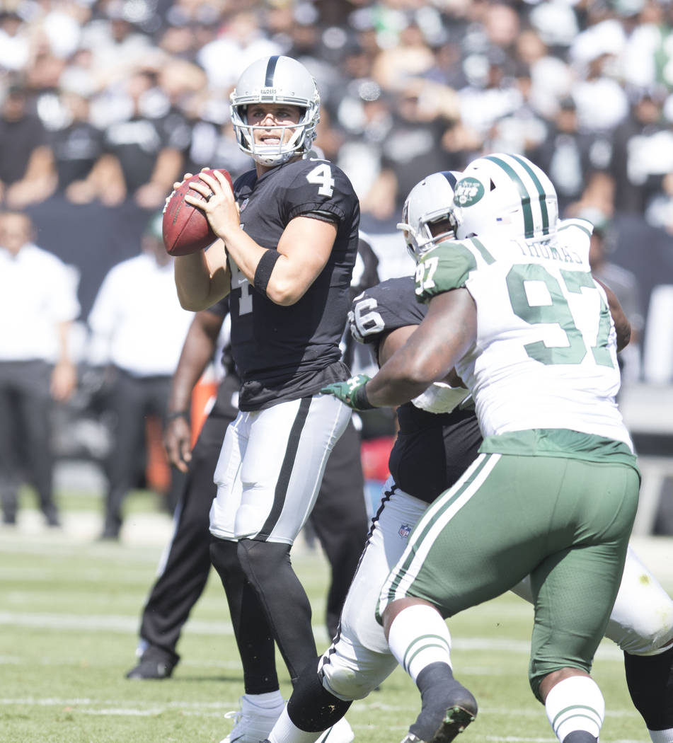 Oakland Raiders quarterback Derek Carr (4) prepares to throw the football against the New York Jets in Oakland, Calif., Sunday, Sept. 17, 2017. Heidi Fang Las Vegas Review-Journal @HeidiFang