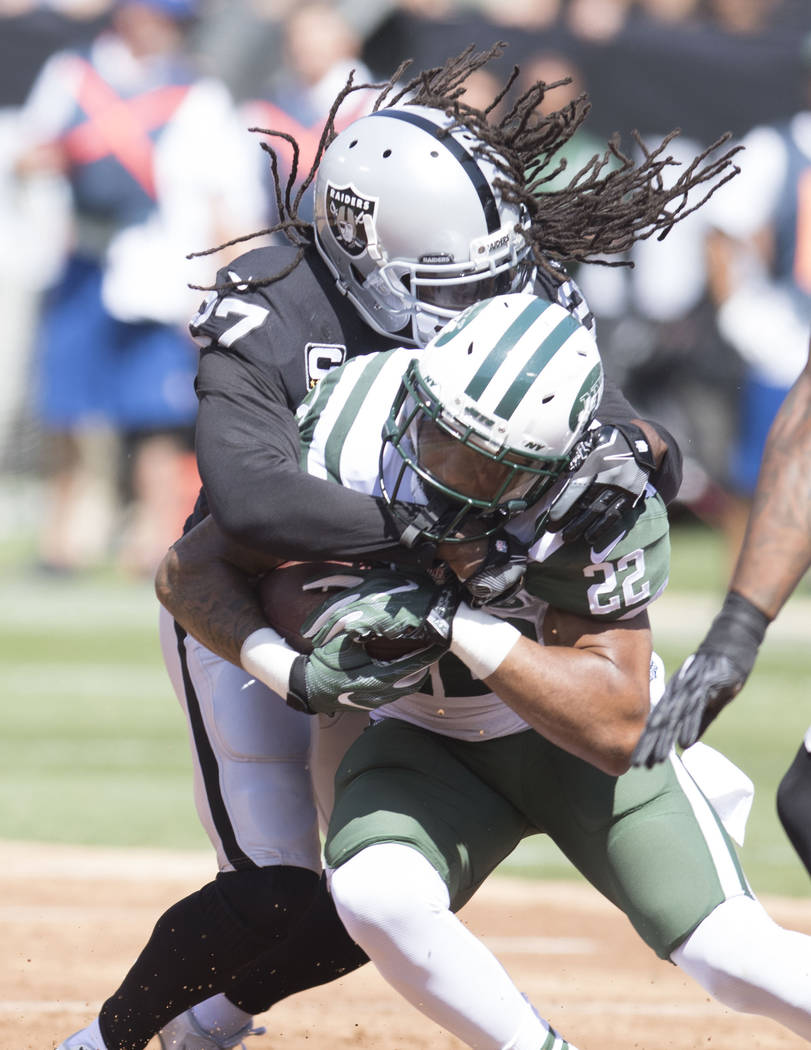 Oakland Raiders free safety Reggie Nelson (27) tackles New York Jets running back Matt Forte (22) in the first half of their game in Oakland, Calif., Sunday, Sept. 17, 2017. Heidi Fang Las Vegas R ...