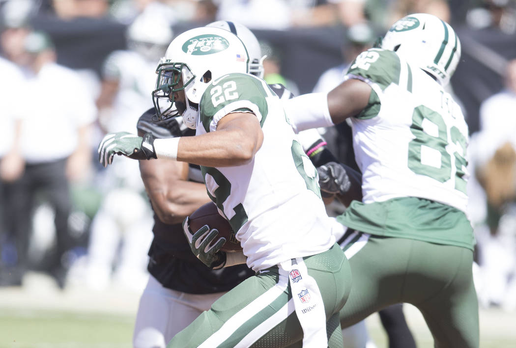 New York Jets running back Matt Forte (22) runs with the football in the first half of their game against the Oakland Raiders in Oakland, Calif., Sunday, Sept. 17, 2017. Heidi Fang Las Vegas Revie ...