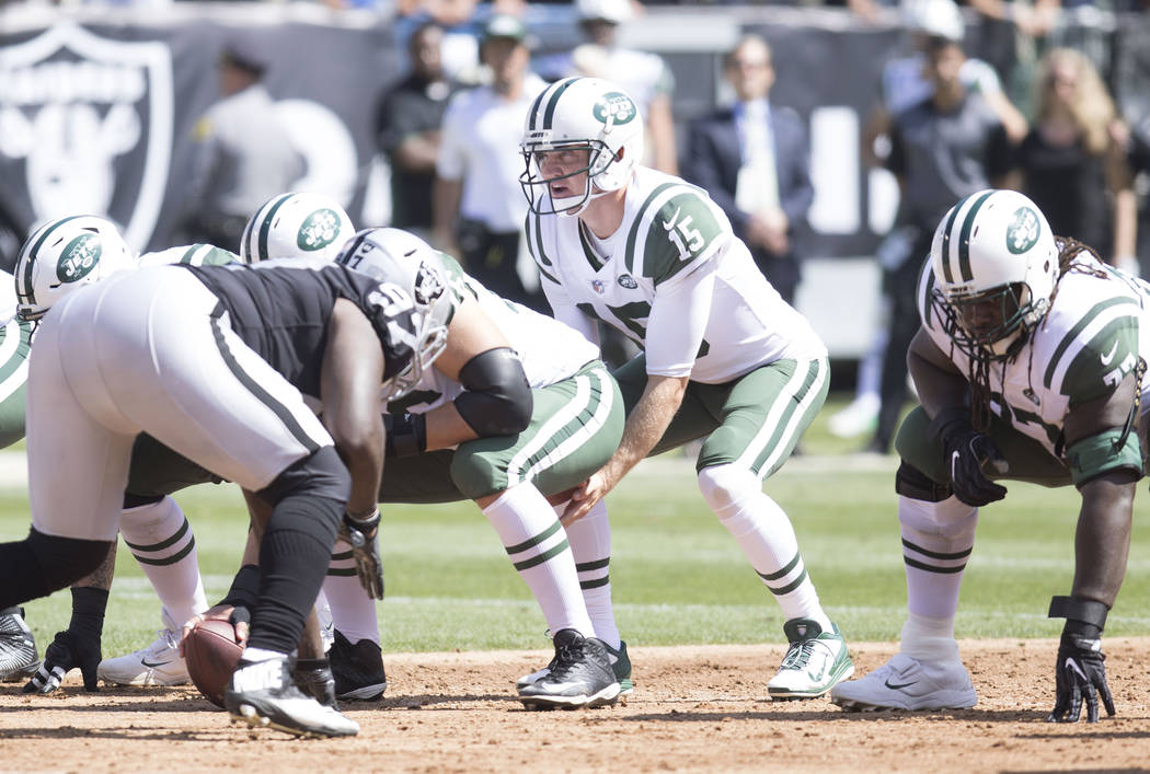New York Jets quarterback Josh McCown (15) calls a play at the line of scrimmage in the first half of their game against the Raiders in Oakland, Calif., Sunday, Sept. 17, 2017. Heidi Fang Las Vega ...
