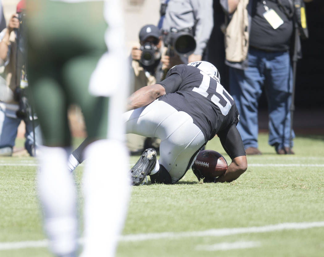 Oakland Raiders wide receiver Michael Crabtree (15) gets in the end zone for a touchdown in the first half of their game against the New York Jets in Oakland, Calif., Sunday, Sept. 17, 2017. Heidi ...