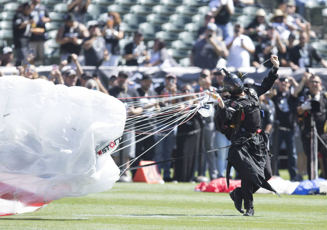 A parachuter lands on the Oakland-Alameda County Coliseum field prior to the start of the Raiders game against the New York Jets in Oakland, Calif., Sunday, Sept. 17, 2017. Heidi Fang Las Vegas Re ...