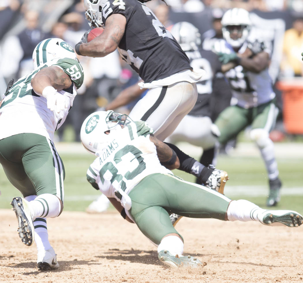 Oakland Raiders running back Marshawn Lynch (24) breaks a tackle by New York Jets strong safety Jamal Adams (33) in the first half of their game in Oakland, Calif., Sunday, Sept. 17, 2017. Heidi F ...