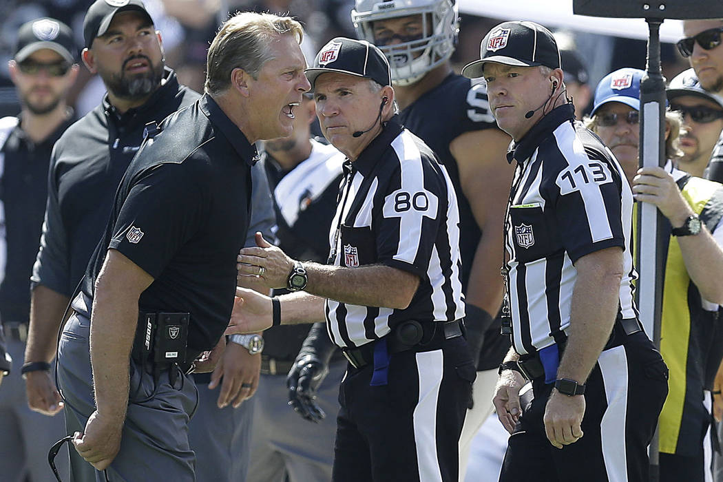 Oakland Raiders head coach Jack Del Rio yells at officials Greg Gautreaux (80) Danny Short during the first half of an NFL football game between the Raiders and the New York Jets in Oakland, Calif ...