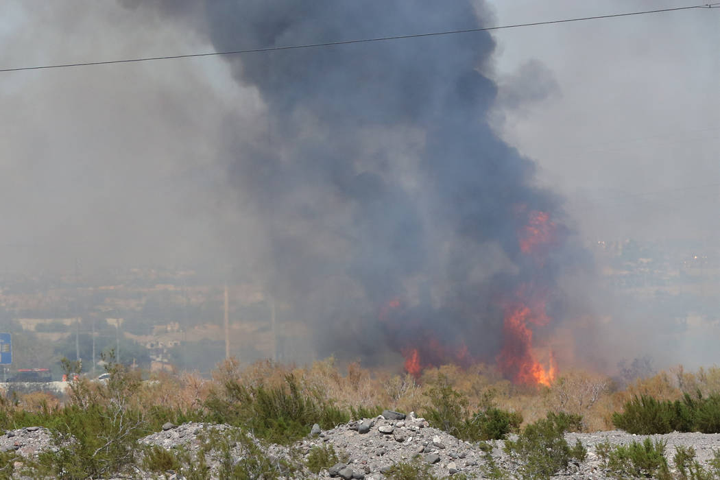 Henderson firefighters are struggling Sunday afternoon, Sept. 17, 2017, to extinguish a 2-acre brush fire in an open area of desert near North Stephanie and Marks Street. (Michael Quine/Las Vegas  ...